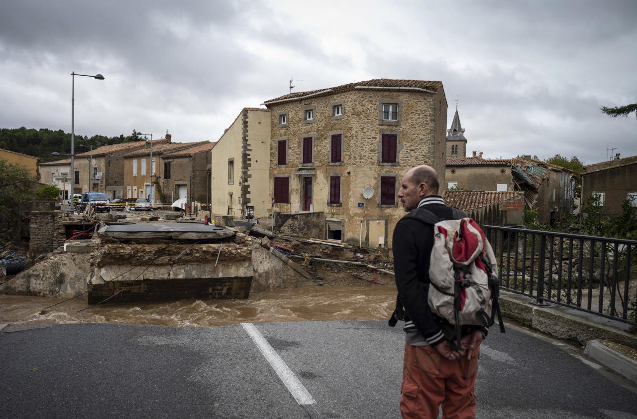 <p>A man watches a damaged bridge over a torrent after flash floods in the town of Villegailhenc, southern France, Monday, Oct.15, 2018. (Photo: Fred Lancelot/AP) </p>