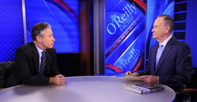 """FILE - This Sept. 22, 2010 file photo shows Comedy Central's Jon Stewart from """"The Daily Show with Jon Stewart,"""" left, and and political pundit Bill O'Reilly during an interview for """"The O'Reilly Factor"""" on FOX News Channel, in New York.  O'Reilly and Jon Stewart face off for a special 90-minute debate about the 2012 presidential race. The live debate will be streamed online on Oct. 6, 2012 from George Washington University in Washington, D.C. The price is $4.95, with one-half of the profits donated to a number of unspecified charities. (AP Photo/Peter Kramer, file)"""