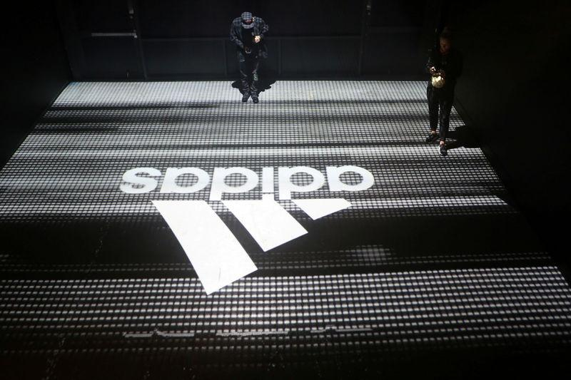 FILE PHOTO: An Adidas logo is seen at the new Futurecraft shoe unveiling event in New York City