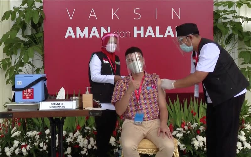 Indonesian influencer Raffi Ahmad receives a shot of the coronavirus disease (COVID-19) vaccine at the Merdeka Palace in Jakarta
