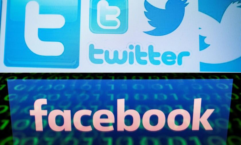 (COMBO) This combination of file pictures created on August 22, 2018 shows a photo illustration taken on March 23, 2018 of Twitter logos on a computer screen in Beijing and a file illustration picture taken on April 28, 2018 of the logo of social network Facebook displayed on a screen and reflected on a tablet in Paris. - A concerted Russian hacking and online disinformation campaign in 2016 sought to tip the US presidential election toward Donald Trump. Two weeks ahead of midterm congressional elections, Moscow's operatives are at it again. The shutdown of thousands of Russian-controlled accounts by Twitter and Facebook -- plus the indictments of 14 people from Russia's notorious troll farm the Internet Research Agency -- have blunted but by no means halted their efforts to influence US politics. (Photos by NICOLAS ASFOURI and Lionel BONAVENTURE / AFP) (Photo credit should read NICOLAS ASFOURI,LIONEL BONAVENTURE/AFP/Getty Images)