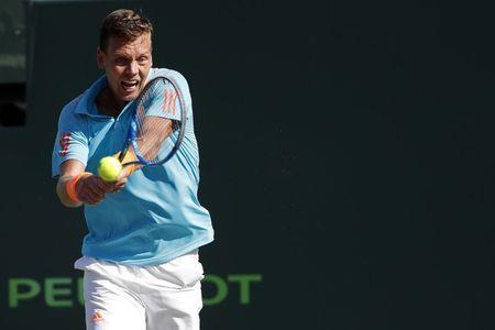 Mar 30, 2017; Miami, FL, USA; Tomas Berdych of the Czech Republic hits a backhand against Roger Federer of Switzerland (not pictured) in a men's singles quarter-final during the 2017 Miami Open at Crandon Park Tennis Center. Federer won 6-2, 3-6, 7-6(6). Mandatory Credit: Geoff Burke-USA TODAY Sports