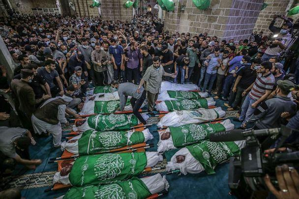 PHOTO: Palestinians attend a funeral for people killed in an Israeli air strike in Gaza City, May 13, 2021. (Haitham Imad/EPA via Shutterstock)