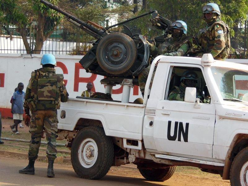 U.N. peacekeepers take a break as they patrol along a street during the presidential election in Bangui, the capital of Central African Republic, December 30, 2015.  REUTERS/Media Coulibaly