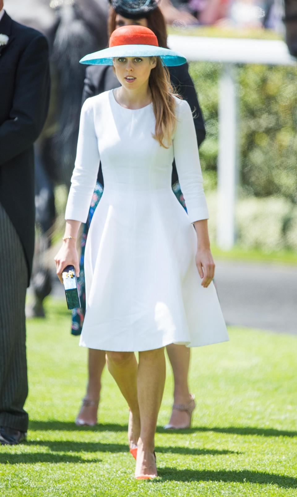<p>A favourite of Ascot, Beatrice let her hat do the talking when she attended wearing a simple white dress by Seraphina when she went in 2015. <em>[Photo: Getty]</em> </p>