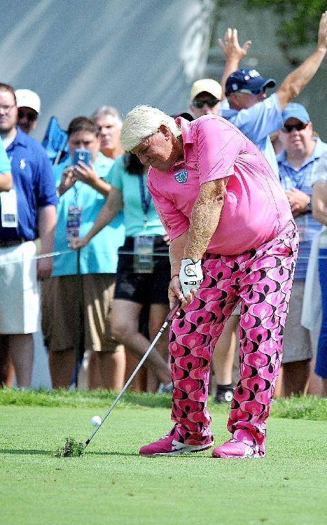 John Daly tees off on the 18th hole during the first round of the Greenbrier Classic golf tournament at the Greenbrier Resort in White Sulphur Springs, W.Va., Thursday July 3, 2014 (AP Photo/Chris Tilley)