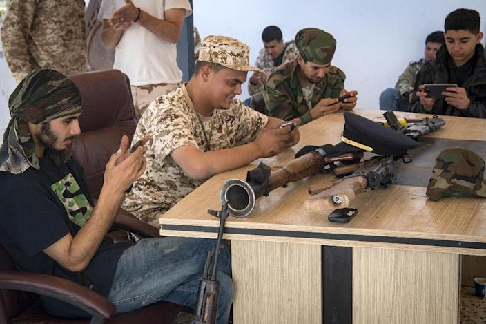 "Fighters loyal to Libya's internationally recognised government play the online video game ""PlayerUnknown's Battlegrounds"" during a lull in fighting near Tripoli (AFP Photo/FADEL SENNA)"