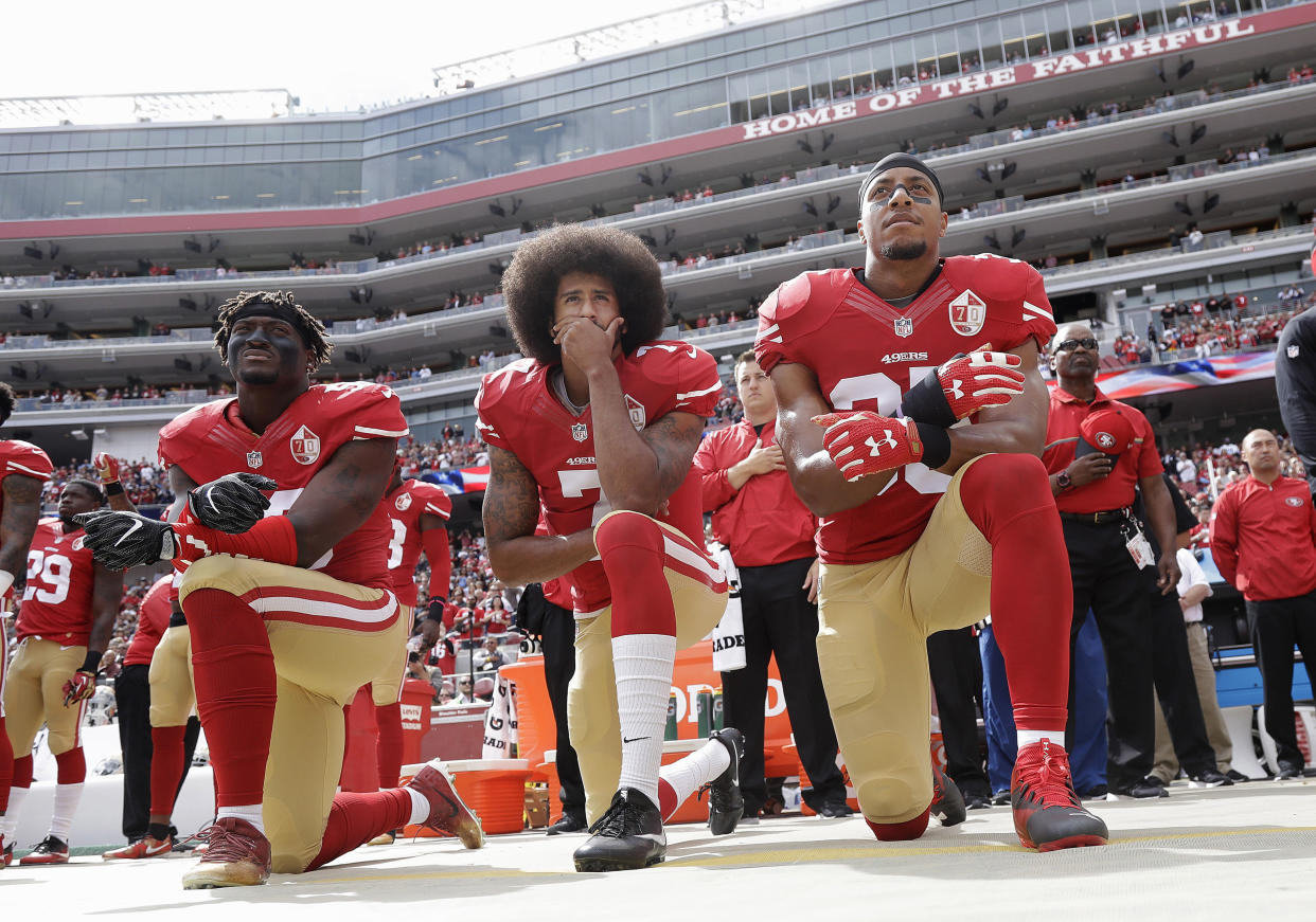 San Francisco 49ers outside linebacker Eli Harold, former quarterback Colin Kaepernick, center, and former safety Eric Reid kneel during the national anthem before an NFL football game against the Dallas Cowboys in Santa Clara, Calif., on Oct. 2, 2016. (AP Photo/Marcio Jose Sanchez, File)