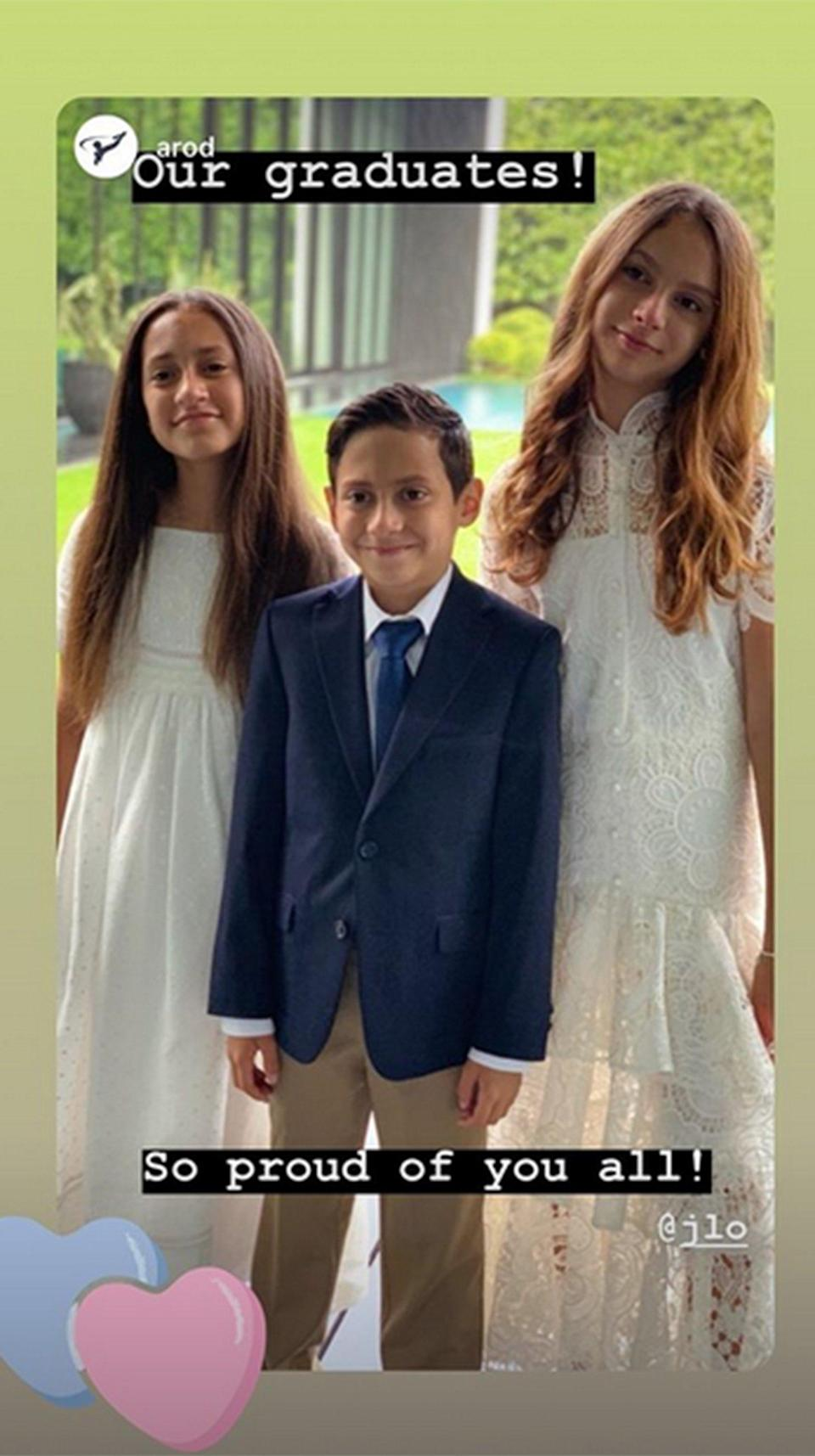 """Jennifer Lopez's twins Emme and Max and Alex Rodriguez's youngest daughter Ella are moving on up to the sixth grade. Rodriguez took an Instagram snap of all three kids and added the caption: """"Our graduates! So proud of you all!"""" The delighted dad also tagged fiancée Lopez in the photo so, of course, the happy mom of twins had to repost the sweet photo on her Instagram as well."""