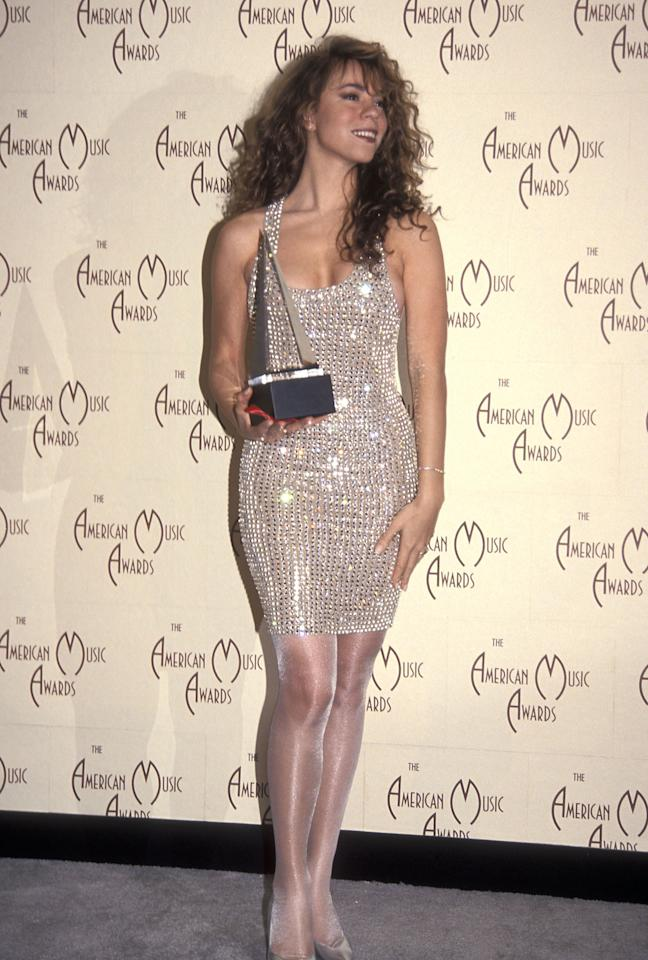 <p>Mariah Carey attends the 19th Annual American Music Awards on January 27, 1992 at the Shrine Auditorium in Los Angeles, California wearing a sequin dress and shimmering tights.</p>