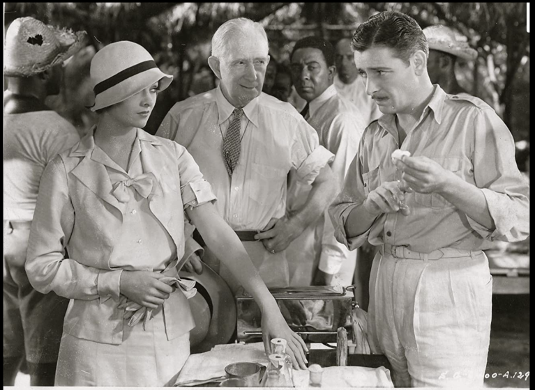 Ronald Colman (right) as Martin Arrowsmith prepares to fight a plague outbreak in the Caribbean as Myrna Loy and Alec B. Francis watch in the 1931 film version of the Sinclair Lewis novel.