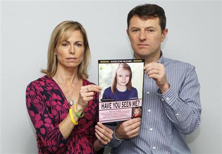 File photograph shows Kate and Gerry McCann posing with a computer generated image of how their missing daughter Madeleine might look, during a news conference in London