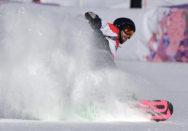 Britain's Billy Morgan finishes a run during the men's snowboard slopestyle semifinal at the Rosa Khutor Extreme Park, at the 2014 Winter Olympics, Saturday, Feb. 8, 2014, in Krasnaya Polyana, Russia. (AP Photo/Andy Wong)