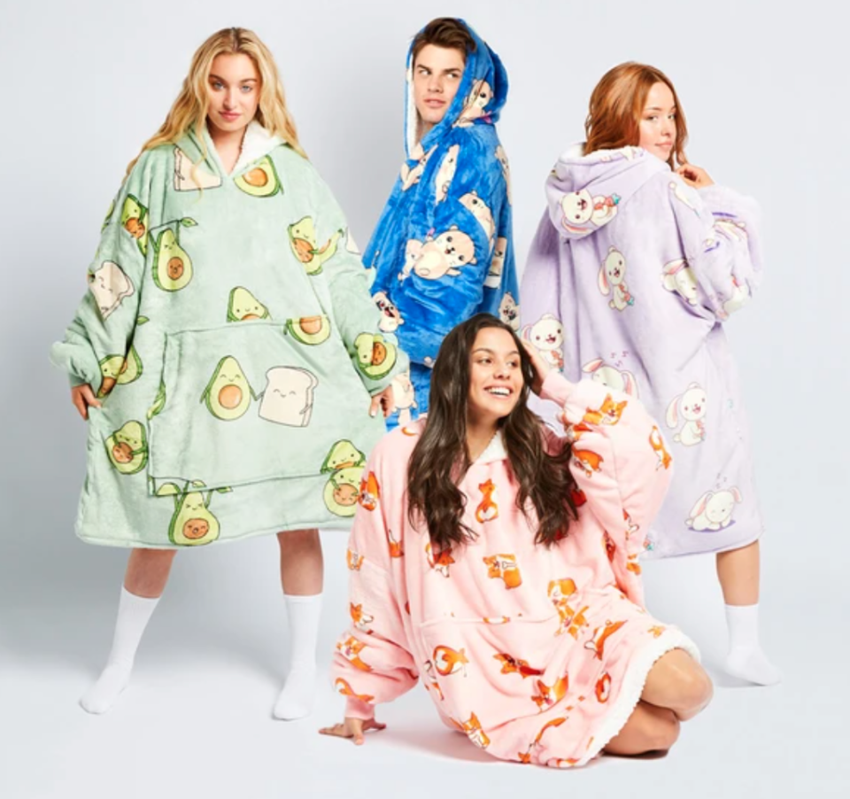 family dressed in Oodies hooded blankets currently on sale