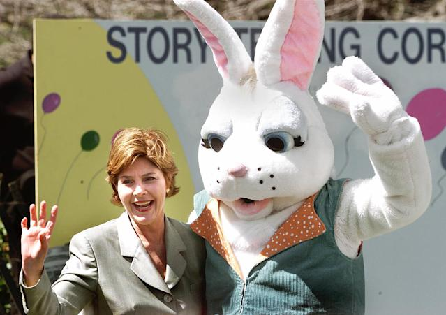 <p>First lady Laura Bush waves with the Easter Bunny at the annual White House Easter Egg Roll, Monday, April 1, 2002, in Washington. 10,800 eggs were boiled, the president's dog was captured in a chocolate sculpture and the White House opened the gates to hundreds of children for the annual egg roll on the South Lawn. (Photo: Ron Edmonds/AP) </p>