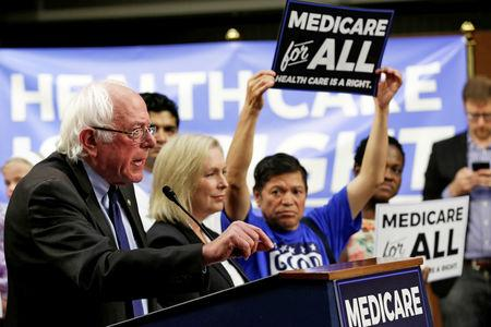 """FILE PHOTO:    Senator Bernie Sanders (I-VT) speaks during an event to introduce the """"Medicare for All Act of 2017"""" on Capitol Hill in Washington, U.S., September 13, 2017. REUTERS/Yuri Gripas/File Photo"""