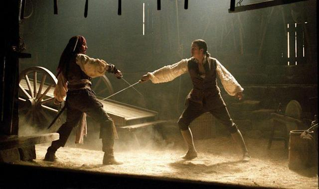 Jack Sparrow (played by Johnny Depp, left) and Will Turner (Orlando Bloom) first met each other with a sword fight in <em>Pirates of the Caribbean: Curse of the Black Pearl</em>. (Photo: Walt Disney/courtesy Everett Collection)