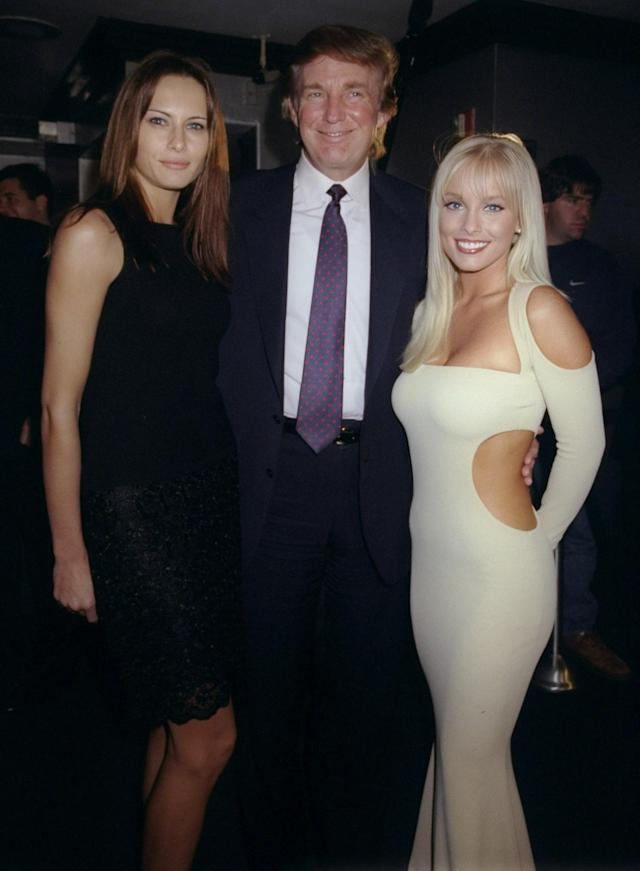 <p>Donald Trump is flanked by his date, model Melania Knauss, and Jaime Bergman at a party celebrating <em>Playboy</em> magazine's 45th anniversary at the Life Club in New York City on Dec. 3, 1998. (Photo: Richard Corkery/NY Daily News Archive via Getty Images) </p>