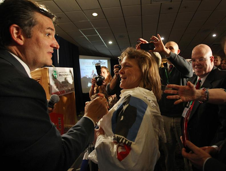 Sen. Ted Cruz, R-Texas, is greeted by supporters after speaking at a GOP Freedom Summit, Saturday, April 12, 2014 in Manchester, N.H. Several potential Republican White House contenders _ among them Kentucky Sen. Rand Paul, Cruz, and former Arkansas Gov. Mike Huckabee _ headline a conference Saturday in New Hampshire, hosted by the conservative groups Citizens United and Americans for Prosperity. (AP Photo/Jim Cole)