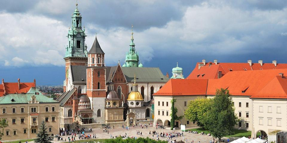 """<p>If you love grand architecture, Krakow is definitely worth a visit. In this up-and-coming city, you can explore the Old Town where you can take a tour of the 13th-century <a href=""""https://go.redirectingat.com?id=74968X1596630&url=https%3A%2F%2Fwww.tripadvisor.com%2FAttraction_Review-g274772-d276748-Reviews-Wawel_Royal_Castle-Krakow_Lesser_Poland_Province_Southern_Poland.html&sref=https%3A%2F%2Fwww.redbookmag.com%2Flife%2Fg37132507%2Fup-and-coming-travel-destinations%2F"""" rel=""""nofollow noopener"""" target=""""_blank"""" data-ylk=""""slk:Wawel Castle"""" class=""""link rapid-noclick-resp"""">Wawel Castle</a>, visit the <a href=""""https://go.redirectingat.com?id=74968X1596630&url=https%3A%2F%2Fwww.tripadvisor.com%2FAttraction_Review-g274772-d276749-Reviews-Wawel_Cathedral-Krakow_Lesser_Poland_Province_Southern_Poland.html&sref=https%3A%2F%2Fwww.redbookmag.com%2Flife%2Fg37132507%2Fup-and-coming-travel-destinations%2F"""" rel=""""nofollow noopener"""" target=""""_blank"""" data-ylk=""""slk:Wawel Cathedral"""" class=""""link rapid-noclick-resp"""">Wawel Cathedral</a>, and stroll the main square (the largest in Europe). </p><p>There are also plenty of cafes, plus beer bars serving both local and Europeans brews, and hotels like <a href=""""https://go.redirectingat.com?id=74968X1596630&url=https%3A%2F%2Fwww.tripadvisor.com%2FHotel_Review-g274772-d276783-Reviews-Hotel_Copernicus-Krakow_Lesser_Poland_Province_Southern_Poland.html&sref=https%3A%2F%2Fwww.redbookmag.com%2Flife%2Fg37132507%2Fup-and-coming-travel-destinations%2F"""" rel=""""nofollow noopener"""" target=""""_blank"""" data-ylk=""""slk:Copernicus"""" class=""""link rapid-noclick-resp"""">Copernicus</a> and the <a href=""""https://go.redirectingat.com?id=74968X1596630&url=https%3A%2F%2Fwww.tripadvisor.com%2FHotel_Review-g274772-d321158-Reviews-Sheraton_Grand_Krakow-Krakow_Lesser_Poland_Province_Southern_Poland.html&sref=https%3A%2F%2Fwww.redbookmag.com%2Flife%2Fg37132507%2Fup-and-coming-travel-destinations%2F"""" rel=""""nofollow noopener"""" target=""""_blank"""" data-ylk=""""slk:Sheraton Grand"""" class=""""link rapid"""