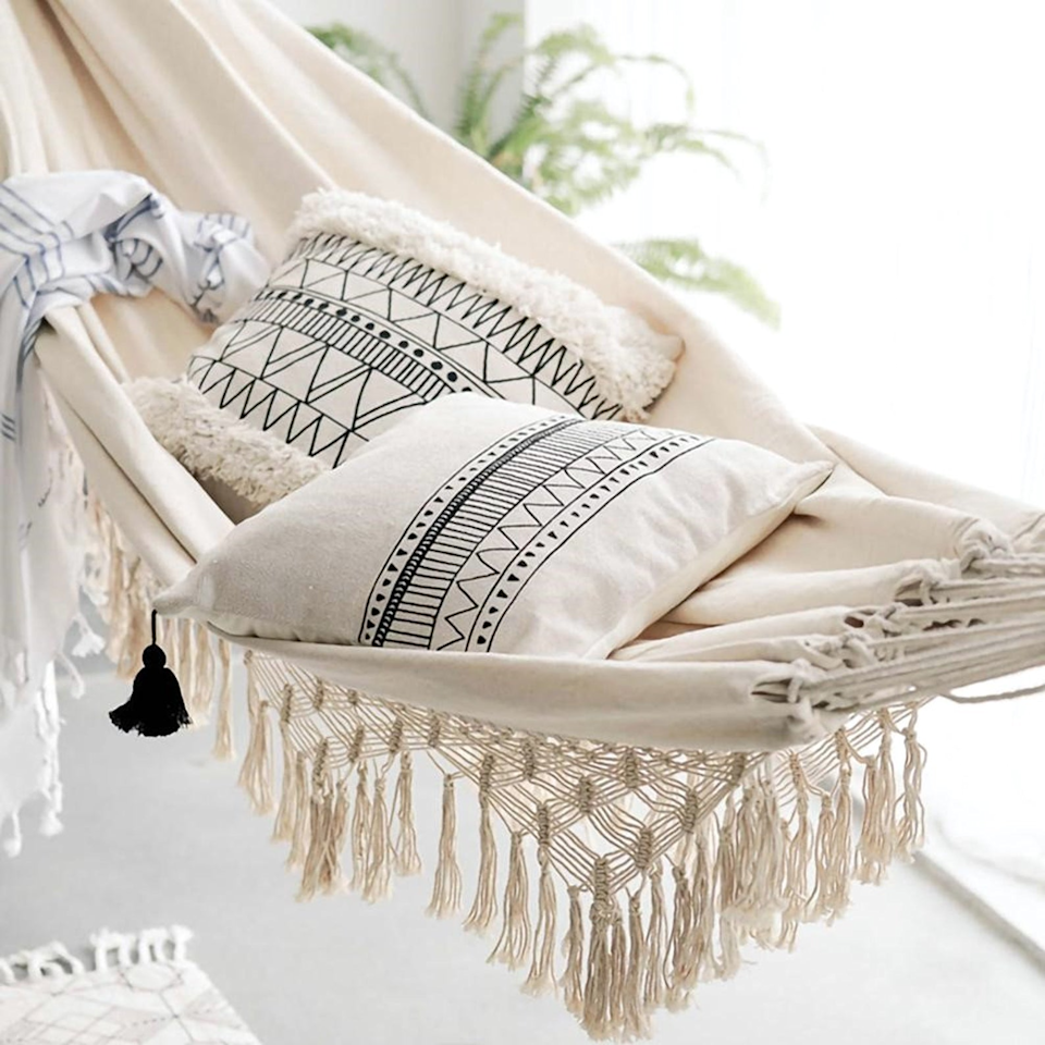 "<h3><a href=""https://www.etsy.com/listing/853579594/large-2-person-hammock-boho-style"" rel=""nofollow noopener"" target=""_blank"" data-ylk=""slk:HuanLei Macrame Fringed Double Hammock"" class=""link rapid-noclick-resp"">HuanLei Macrame Fringed Double Hammock </a></h3><br><strong>When an outdoor oasis isn't in the building plan</strong>: Hang a cotton hammock from a nook inside your small space to bring the breezy outside vibes inside.<br><br><strong>HuanLei</strong> Macrame Fringed Double Hammock, $, available at <a href=""https://go.skimresources.com/?id=30283X879131&url=https%3A%2F%2Fwww.etsy.com%2Flisting%2F853579594%2Flarge-2-person-hammock-boho-style"" rel=""nofollow noopener"" target=""_blank"" data-ylk=""slk:Etsy"" class=""link rapid-noclick-resp"">Etsy</a>"