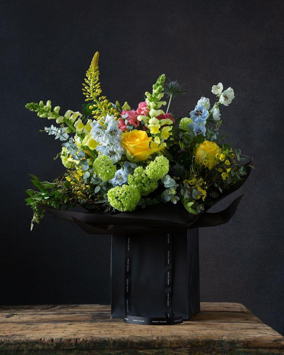 "<p>The brilliant London florist Ronny Colbie has collaborated with Lockdown Liquor for bouquets with a side of cocktails. <a href=""https://ronnycolbie.com/"" rel=""nofollow noopener"" target=""_blank"" data-ylk=""slk:Choose"" class=""link rapid-noclick-resp"">Choose</a> a blend that complements your flowers – like the Tetbury arrangement bursting with yellow roses, gelda viburnum and delphiniums with the bright Tucci (a vodka and juniper water twist on the classic Negroni).</p>"