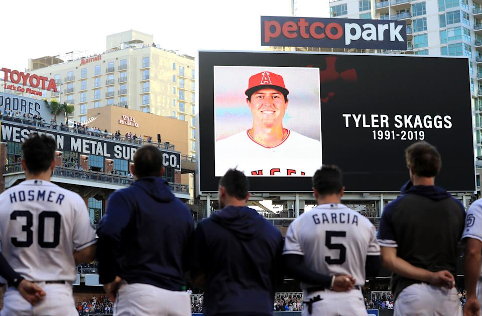 Players for the San Diego Padres and San Francisco Giants stand during a moment of silence for pitcher Tyler Skaggs of the Los Angeles Angels of Anaheim at PETCO Park on July 01, 2019 in San Diego, California.  Skaggs passed away in his hotel room earlier in the day in Texas.  (Photo by Sean M. Haffey/Getty Images)