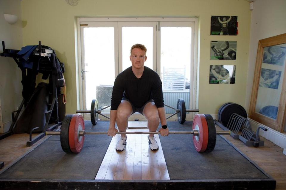 Greg Rutherford lifting weights in his house during training earlier this year.