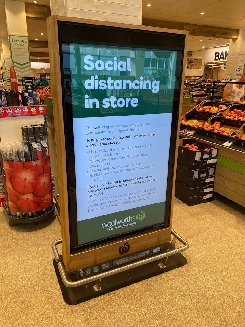 A sign warning customers about social distancing in a Woolworths in Sydney.
