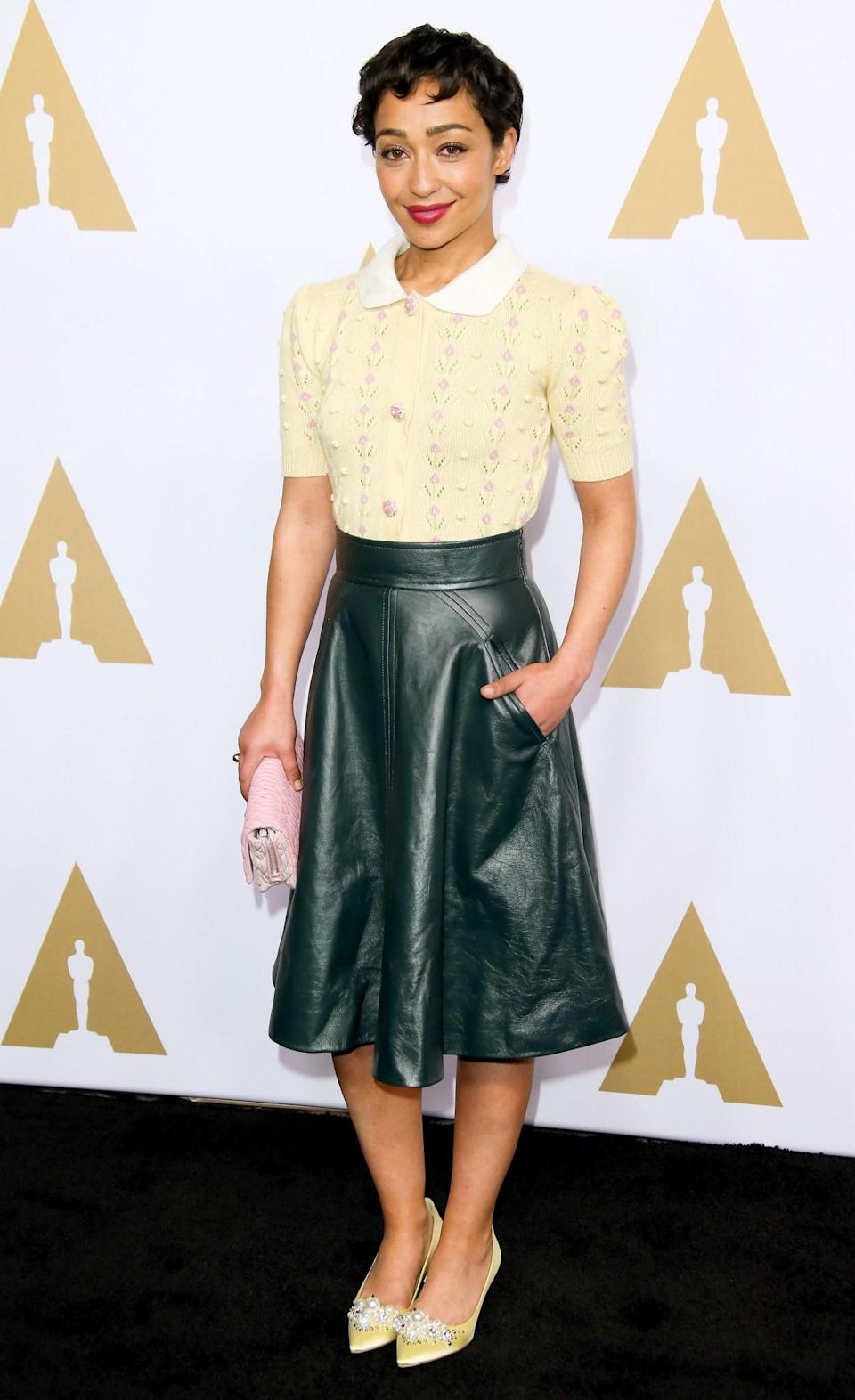 <p>Ruth Negga went for a chic smart/casual approach, wearing a bottle green leather skirt and adorned Miu Miu blouse. [Photo: Getty] </p>