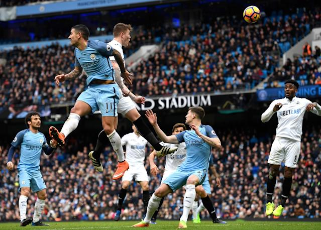 <p>Alfie Mawson of Swansea City heads wide from a corner during the Premier League match between Manchester City and Swansea City at Etihad Stadium on February 5, 2017 in Manchester, England. </p>