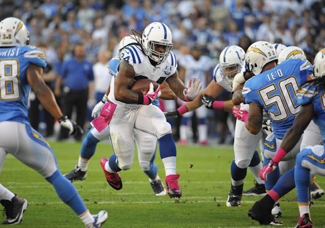 Indianapolis Colts running back Trent Richardson, center, runs upfield against the San Diego Chargers during the first half of an NFL football game Monday, Oct. 14, 2013, in San Diego. (AP Photo/Denis Poroy)