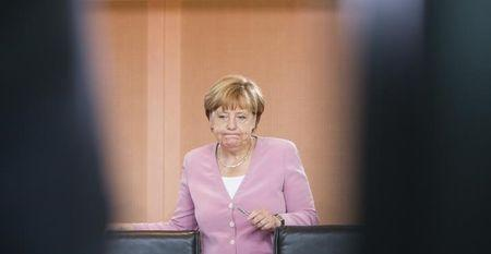 German chancellor Angela Merkel reacts as she arrives for the weekly cabinet meeting at the chancellery in Berlin, Germany August 12, 2015. REUTERS/Stefanie Loos