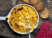 """<p>If you're not serving macaroni and cheese at Thanksgiving, you're doing it wrong. Pasta and cheese casseroles were popular hundreds of years ago throughout Europe, so it's a little unclear as to how mac and cheese itself came about. But according to <a href=""""https://food52.com/blog/9916-the-history-of-macaroni-and-cheese"""" rel=""""nofollow noopener"""" target=""""_blank"""" data-ylk=""""slk:Food52"""" class=""""link rapid-noclick-resp"""">Food52</a>, in 1769, the book <em>The Experienced English Housekeeper</em>, by Elizabeth Raffald, included a recipe that mixed béchamel sauce with cheddar cheese to put over a noodle casserole with breadcrumbs and Parmesan. </p><p>Some say it was brought to America by colonial settlers, others say Thomas Jefferson made it popular after enjoying it overseas. </p>"""