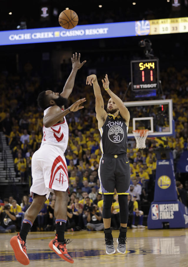 Golden State Warriors guard Stephen Curry (30) shoots against Houston Rockets guard James Harden during the second half of Game 4 of the NBA basketball Western Conference Finals in Oakland, Calif., Tuesday, May 22, 2018. (AP Photo/Marcio Jose Sanchez)