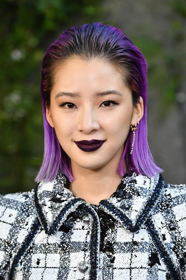<p>Purple hair and lips was a winning combo for Kim's front-row look at the Chanel show. (Photo: Getty Images) </p>
