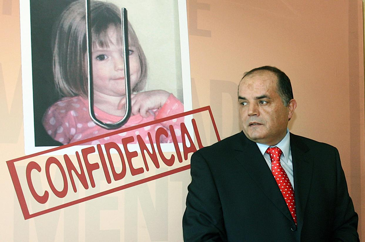 Former Policia Judiciaria (Crime Police) detective Goncalo Amaral poses near a poster with his book entitled