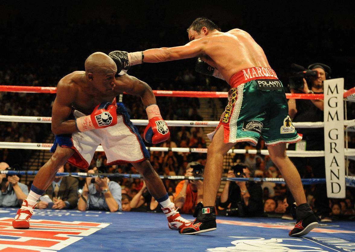 Floyd Mayweather (L) of the US is hit by Juan Manuel Marquez of Mexico in a 2009 fight