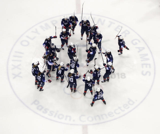 <p>The United States players celebrate after the semifinal round of the women's hockey game against Finland at the 2018 Winter Olympics in Gangneung, South Korea, Monday, Feb. 19, 2018. the United States won 5-0. (AP Photo/Julio Cortez) </p>