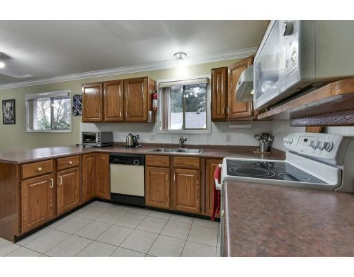 """<p><a rel=""""nofollow"""">2172 Fraser Ave., Port Coquitlam, B.C.</a><br />The kitchen has new laminate flooring, and ample space for cooking with friends and family.<br />(Photo courtesy Zoocasa) </p>"""