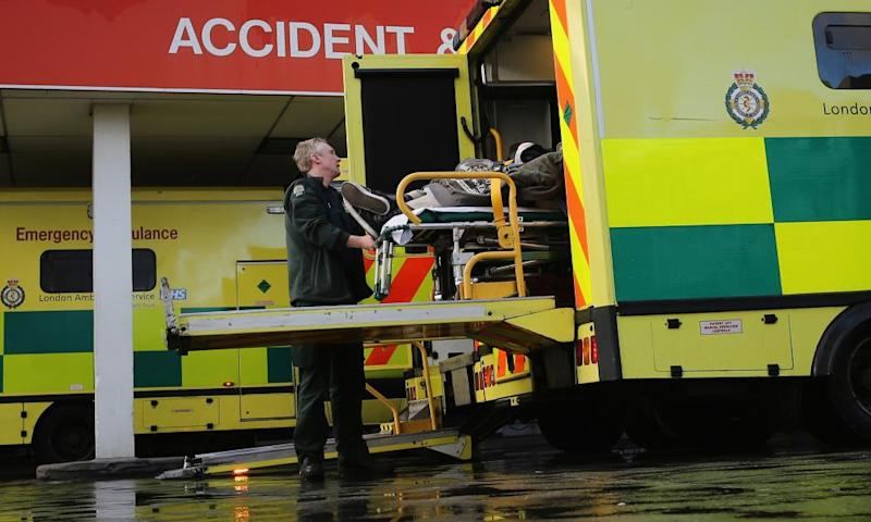 A patient is taken from an ambulance outside the Accident and Emergency ward at St Thomas' Hospital