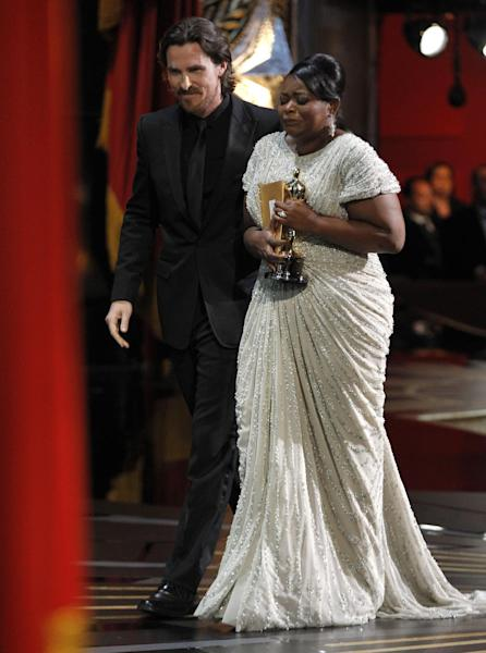 "Octavia Spencer leaves the stage after accepting the Oscar for best actress in a supporting role for ""The Help"" during the 84th Academy Awards on Sunday, Feb. 26, 2012, in the Hollywood section of Los Angeles. At left is presenter Christian Bale. (AP Photo/Chris Carlson)"