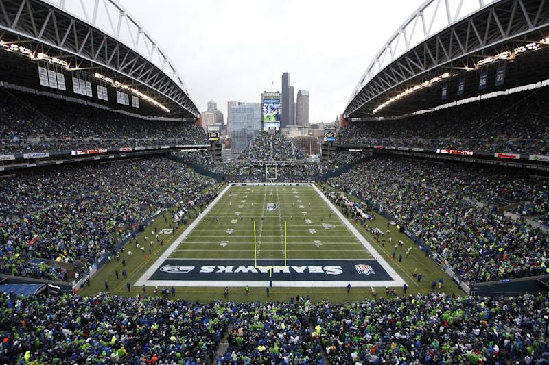FILE - In this Jan. 11, 2014 file photo, fans at CenturyLink Field watch during the first quarter of an NFC divisional playoff NFL football game between the Seattle Seahawks and the New Orleans Saints in Seattle. Fox Sports will use this weekend's NFC title game in Seattle between the San Francisco 49ers and the Seahawks to test an infrared camera that will show how players' body temperatures change throughout the game. (AP Photo/John Froschauer, File)