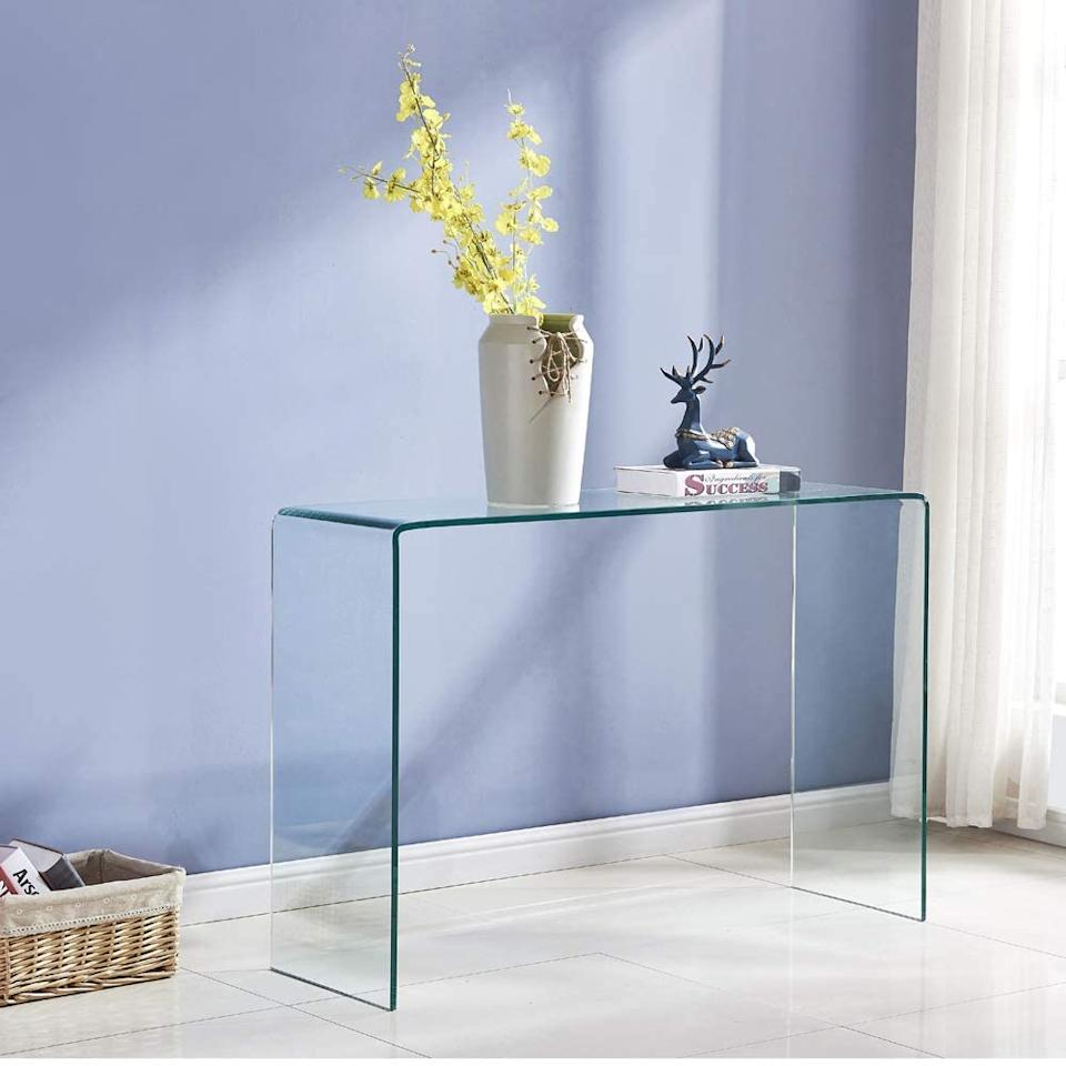 "Made of glossy tempered glass, it'll feel like it hardly takes up any space in your bedroom office. <br><br><strong><em><a href=""https://www.amazon.com/s?k=SMARTYK&ref=bl_dp_s_web_0"" rel=""nofollow noopener"" target=""_blank"" data-ylk=""slk:Shop Amazon"" class=""link rapid-noclick-resp"">Shop Amazon</a></em></strong><br><br><strong>SMARTIK</strong> SMARTIK Transparent Glass Table, $, available at <a href=""https://www.amazon.com/Transparent-Furniture-Tempered-Entryway-43-3x13-78x29-52/dp/B082DZCY7Y/ref=pd_sbs_201_5/142-7177097-2386149?"" rel=""nofollow noopener"" target=""_blank"" data-ylk=""slk:Amazon"" class=""link rapid-noclick-resp"">Amazon</a>"
