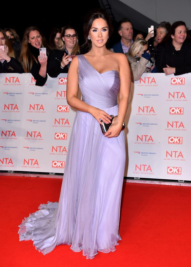 <p>Vicky Pattison graced the red carpet in a lilac-hued one-shoulder dress and finished the aesthetic with co-ordinating make-up. <em>[Photo: Getty]</em> </p>