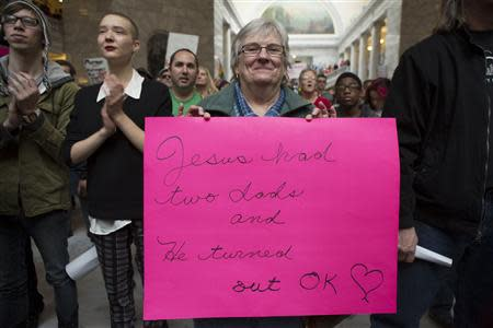 Mary Beth Keidl holds a sign during a rally supporting same-sex marriage at the state capitol in Salt Lake City