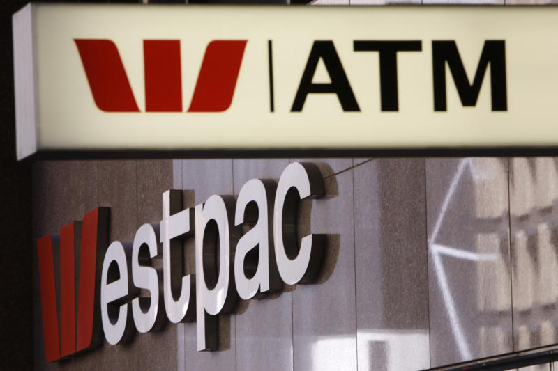 In this Nov. 3, 2010, file photo, signs are displayed at a Westpac branch in Sydney, Australia. Major Australian bank Westpac is facing a potentially massive fine after being accused of 23 million breaches of the anti-money laundering and counterterrorism financing act. (AP Photo/Rick Rycroft, FIle)