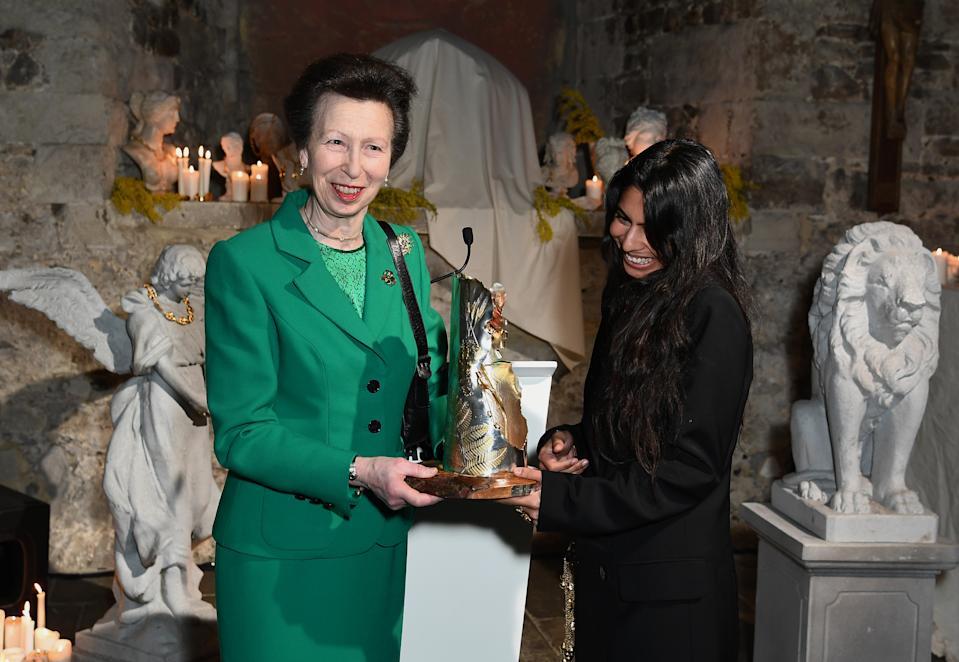 LONDON, ENGLAND - FEBRUARY 18: Princess Anne, Princess Royal presents Rosh Mahtani for Alighieri jewellery line with The Queen Elizabeth II Award for British Design during London Fashion Week February 2020 on February 18, 2020 in London, England. (Photo by Jeff Spicer/BFC/Getty Images for BFC)