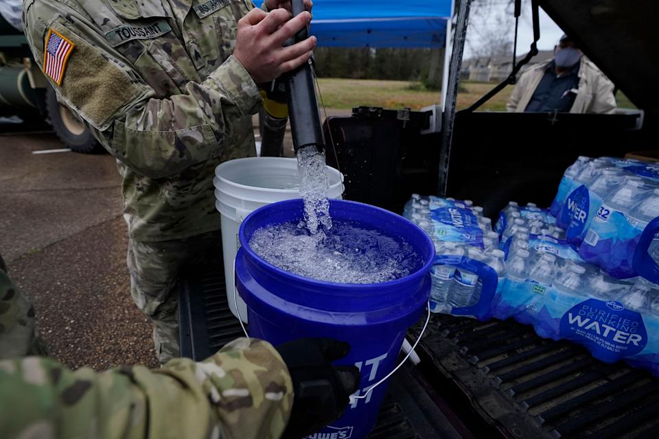 Mississippi Army National Guard Sgt. Chase Toussaint fills five-gallon buckets with nonpotable water at the New Mt. Zion Missionary Baptist Church parking lot on March 1, 2021. Water for flushing toilets was being distributed at seven sites in Mississippi's capital more than 10 days after winter storms wreaked havoc on the city's water system, which is still struggling to maintain consistent water pressure, authorities said. (Photo: Rogelio V. Solis/AP)