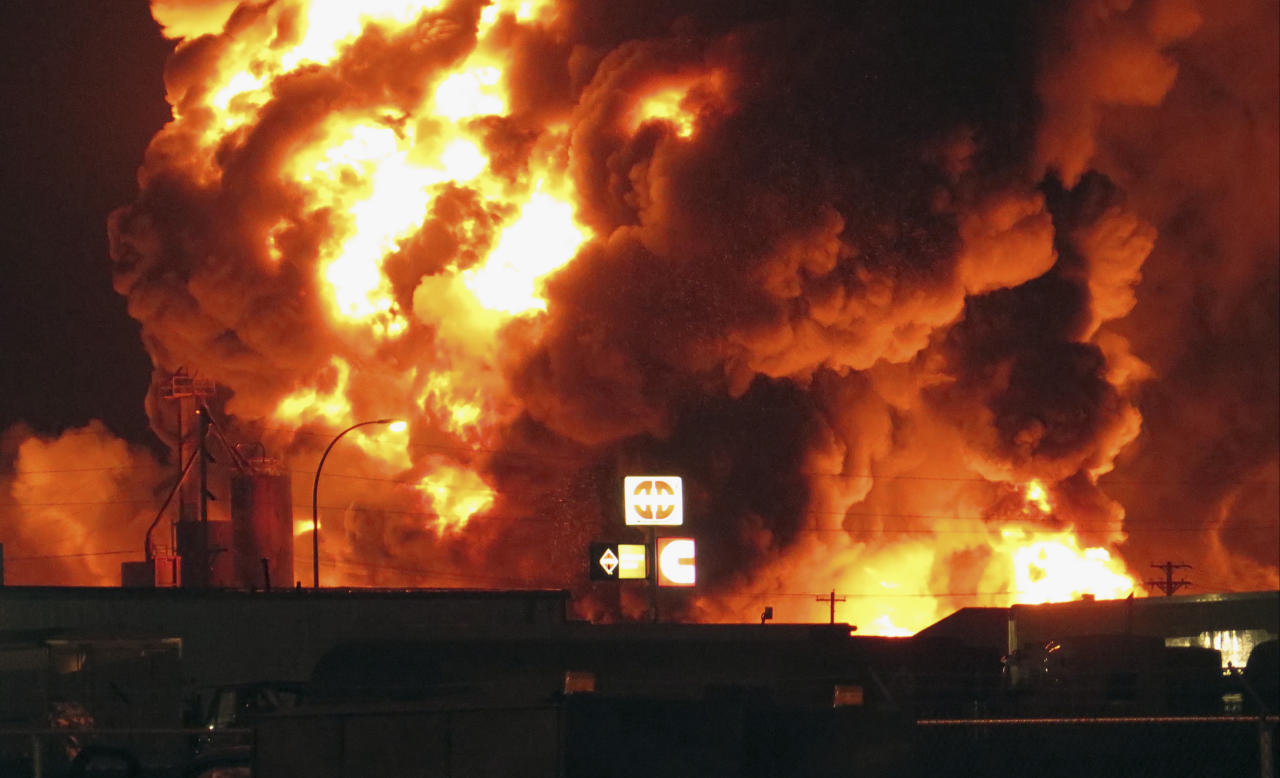 A fire burns at Red River Supply in an industrial part of Williston, N.D., in the early hours of Tuesday, July 22, 2014. The site is near three oil companies and a rail line, just east of Williston's downtown. Explosions could be seen and heard at the scene, but it wasn't immediately clear what caught on fire. No injuries were immediately reported. Red River Supply provides services to oil companies working in North Dakota's oil patch. (AP Photo/Josh Wood)